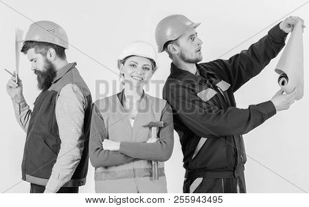 Insubordination concept. Inspector disappointed about employee, builder. Men and woman in helmets carefree with hammer and project , white background. Builder, architect, repairer lazy at work. poster