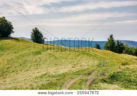 Country Road Through Mountain Ridge. Lovely Countryside Background