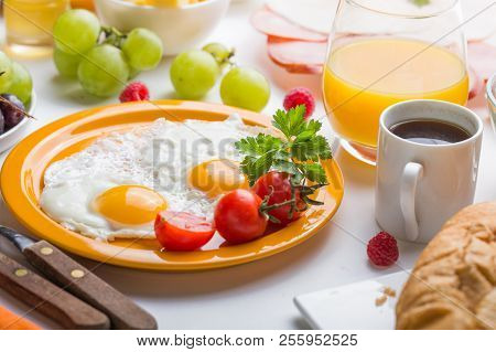 Homemade Breakfast With Sunny Side Up Fried Egg Toast Coffee Fruits Vegetable  And Orange Juice In T