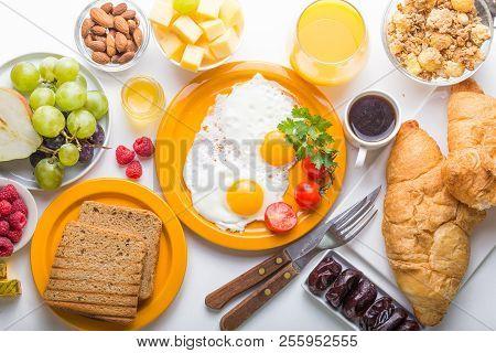 Woman Cooking Breakfast. Healthy Breakfast Ingredients, Food Frame. Granola, Egg, Nuts, Fruits, Berr