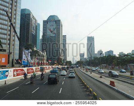 Jakarta, Indonesia - August 24, 2018: Traffic On Jalan Sudirman Around Sudirman Central Business Dis