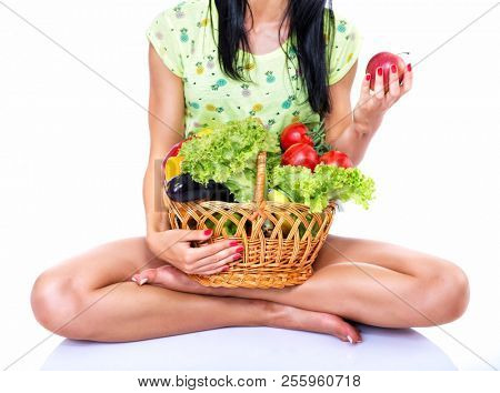 Portrait of slim fitness cherrful girl in studio with set of fruit and vegetables over white background. Healthy eating, diet, fitness, weight lose, fitness diet, workout programs for women concept.