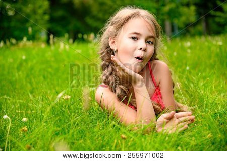 Thoughtful happy girl. Nature of countryside. Ypung and cheerful