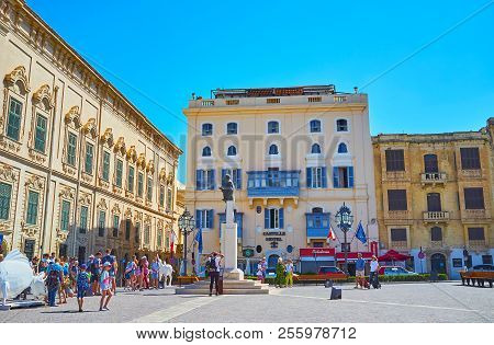 Valletta, Malta - June 17, 2018: The Side Wall Of Auberge Castille, The Edifice Of Hotel And Other M