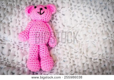 A Soft Pink Teddy Bear, Toy For Infant Girl, Isolated On A White Blanket Background. Sudden Infant D