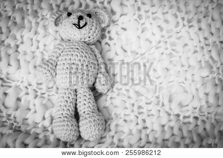 A Soft Teddy Bear, Toy For Infant, Isolated On A White Blanket Background. Sudden Infant Death Syndr