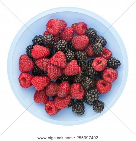 Healthy Food . Blackberry And Raspberry Isolated On White Background. Blackberries And Raspberries O