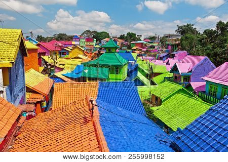 Panoramic View Of Old Colourful Houses Village With Tiled Roofs Painted In Various Colors. Popular P