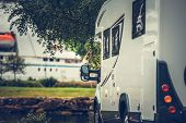 Modern Camper Van on the Campsite. Motorhome Vacation Time. poster