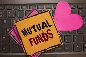 Word writing text Mutual Funds. Business concept for An investment program funded by shareholders Individual Stocks Papers Romantic lovely message Heart Keyboard Type computer Good feelings. poster