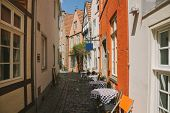 street with summer restaurant and buildings during daytime in Bonn, Germany poster