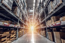 Warehouse Interior With Shelves, Pallets And Boxes, Rows Of Shelves With Goods Boxes In Modern Indus