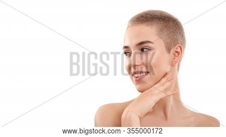 Healthy Skin. Portrait Of A Beautiful Smiling Blond Woman With Short Hair And Nude Make Up Touching