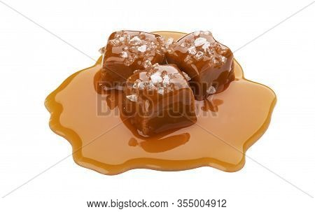 Toffee Candies With Caramel Sauce And Salt Isolated On White Background