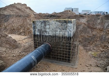 Laying Of Underground Storm Sewer Pipes In Ditch. Installation Of Water Main And Sanitary Sewer At T