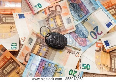 Car Keys Lie On Banknotes Of 20 And 50 Euro.