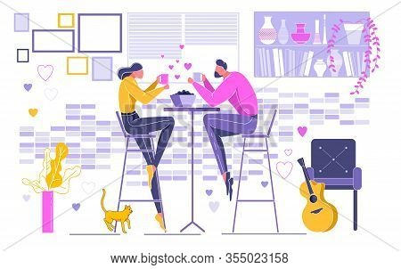 Couple In Love On Date Sitting At Table On Chair Holding Cup Of Drink Coffee Or Tea And Having Dinne