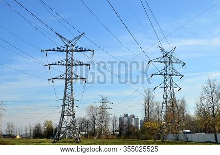 Electricity Concept, High Voltage Power Lines. High Voltage Electric Transmission Pylon Silhouetted