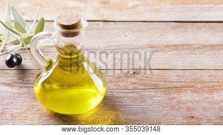 Healthy Fats. Bottle Full Of Extra Virgin Olive Oil Made In Puglia, Salento On A Wooden Table With O