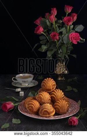 Vintage Breakfast With Madeleines And A Cup Of Tea