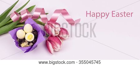 Easter Eggs. Happy Easter Card. Easter Eggs And Tulips With Ribbon On A White Wooden Background. Eas