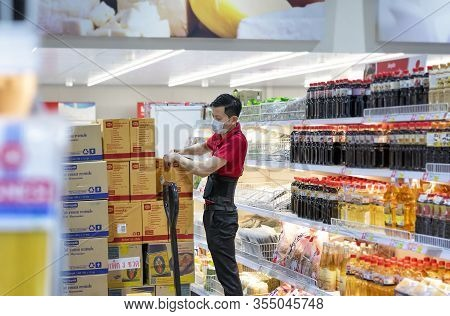 Bangkok, Thailand - March 8: Unidentified Employee Stocks Soy Sauce On The Shelves Of Macro Wholesal