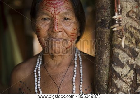Manaus, Amazonas, Brazil - August 17, 2016:  Senior Indigenous Woman With Traditional Adornments And