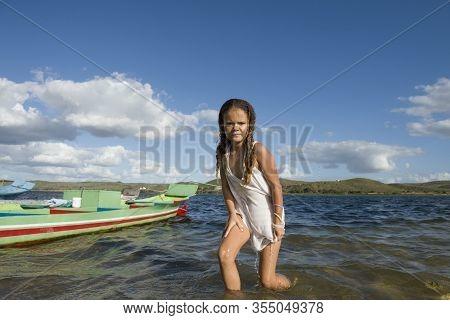 Pao De Acucar, Alagoas, Brazil - June 23, 2016 - Native Young Girl Coming Out The Sao Francisco Rive