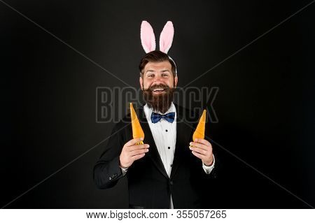 Rabbit Bringing Easter Carrots. Easter Rabbit Black Background. Bearded Man Hold Carrots. Happy Busi