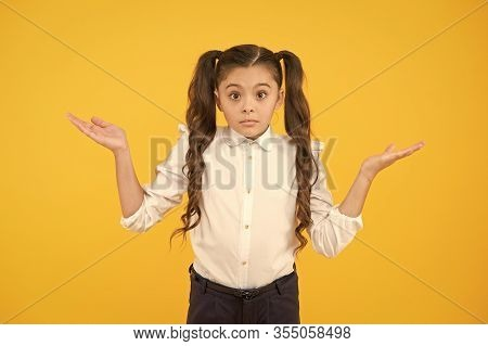I Do Not Know. Puzzled Or Confused. Perfect Schoolgirl Tidy Fancy Hair Puzzled Face Expression. Scho