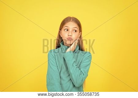 See Your Dentist As Soon As Possible. Little Child Suffer From Toothache Yellow Background. Anti Too