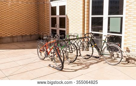 Pittsburgh, Pennsylvania, Usa 3/8/20 Bikes Chained To A Bike Rack Outside Of A Building On The Campu