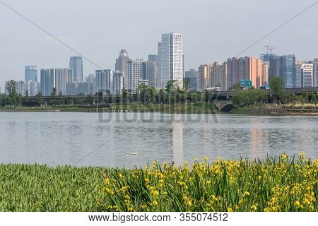 Chengdu, Sichuan Province, China - April 18, 2016 : Modern Skyline In South Chengdu With A Lake In T