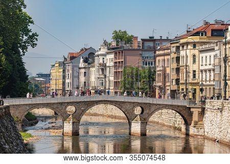 Sarajevo, BiH - August 27, 2019: Latin Bridge on Miljacka River in Sarajevo, Bosnia and Herzegovina