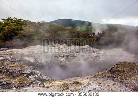 Inferno Crater Lake is a large hot spring. The Waimangu Volcanic Rift Valley. The North Island, New Zealand. The largest geyser-like feature in the world. The concept of exotic and photo tourism