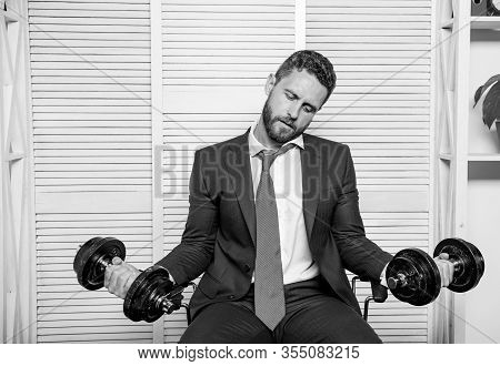 Pressure Tension Stress. Mental And Emotional Tension. Man Raise Heavy Dumbbells. Businessman Manage