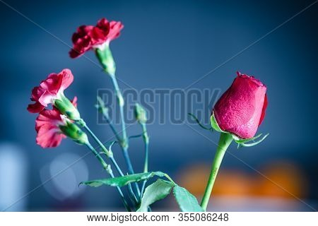 Red Roses Flowers In Vase. Flower In Vase On Blue Background. Flowers For Postcard And Home Decorati