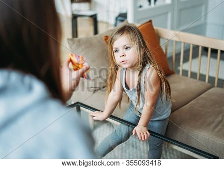 Little Girl With Specialist On Psychological Educational Game, Metaphorical Associative Cards