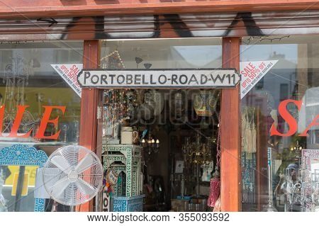 London, United Kingdom- June 2019: Shop Window Of A Store Of Household Goods And Antiques In Portobe