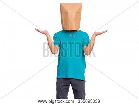 Portrait of teen boy with paper bag over head showing helpless gesture with hands - I do not know. Teenager cover head with bag, isolated on white background. Child making helpless sign or choice.