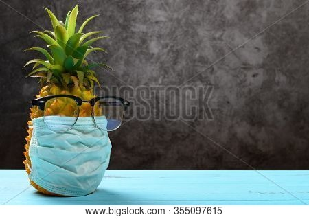 Pineapple Wears A Medical Mask And An Eye Protector Concept Of Protecting Oneself Against The Virus