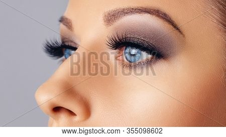 Woman Eyes With Long Eyelashes And Smokey Eyes Make-up. Eyelash Extensions, Makeup, Cosmetics, Beaut