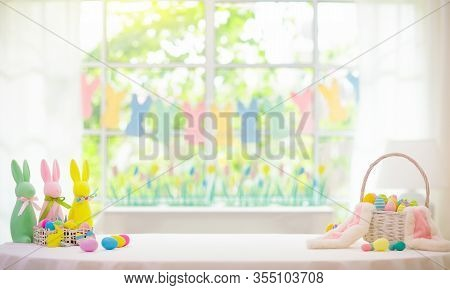 Easter Home Decoration. Eggs Basket And Bunny.