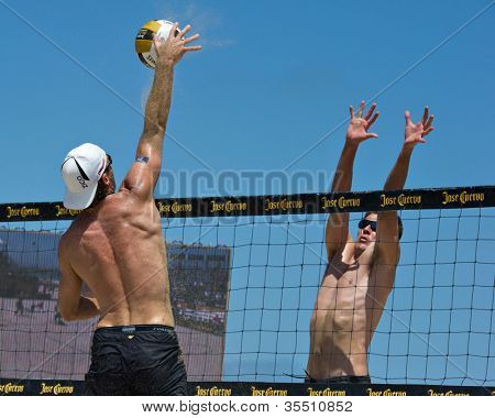 HERMOSA BEACH, CA - JULY 21: Mark Williams and John Hyden compete in the Jose Cuervo Pro Beach Volleyball tournament in Hermosa Beach, CA on July 21, 2012.