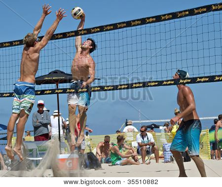 HERMOSA BEACH, CA - JULY 21: Avery Drost, Derek Olson and Matt Motter compete in the Jose Cuervo Pro Beach Volleyball tournament in Hermosa Beach, CA on July 21, 2012.