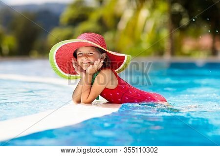 Child With Hat In Swimming Pool. Tropical Vacation