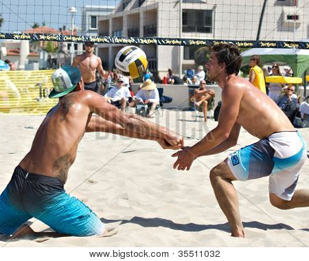 HERMOSA BEACH, CA - JULY 21: Derek Olson and Matt Motter compete in the Jose Cuervo Pro Beach Volleyball tournament in Hermosa Beach, CA on July 21, 2012.