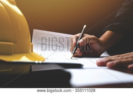 Architect's Desk: Engineer Works With Drawings In A Office. Instruments And Office For Designer. Clo