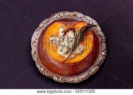 Grilled Baked Peach Stuffed With Blue Cheese Dorblu And Rosemary. Top View