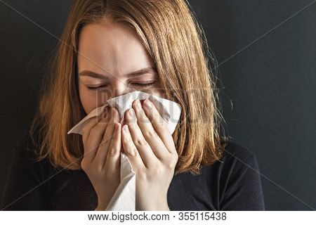 Sick Young Woman, With Wrinkled Nose, Blowing Her Nose And Fever, Caught A Cold, Sneezing In Tissue,